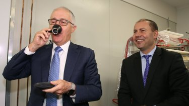 Hard to swallow: Prime Minister Malcolm Turnbull with Josh Frydenberg, the Environment and Energy minister.