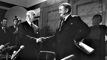 Prime Minister John Gorton shakes hands with William McMahon during a press conference in Canberra on November 7, 1969.