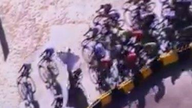 The Tour peloton takes evasive action to dodge around the protestor.
