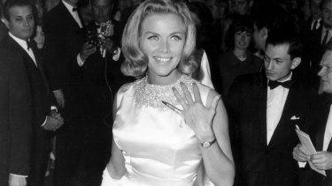 Bond girl Honor Blackman wears Charles de Temple gold on her left hand at the 1964 London premiere of Goldfinger.
