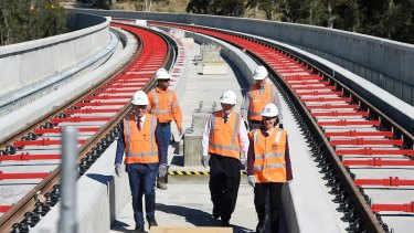 Premier Gladys Berejiklian, right, and Transport Minister Andrew Constance tour the Skytrain viaduct at Rouse Hill.