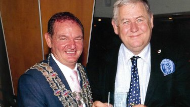 Paul Pisasale (left) presents Steve Potts with an award for diligence.