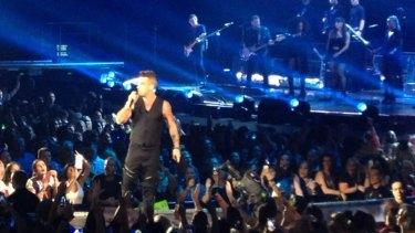 Robbie Williams at the Brisbane Entertainment Centre on Saturday night.
