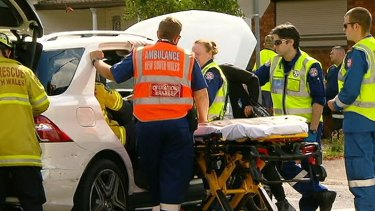 Emergency workers attend the scene of the crash on Monday.
