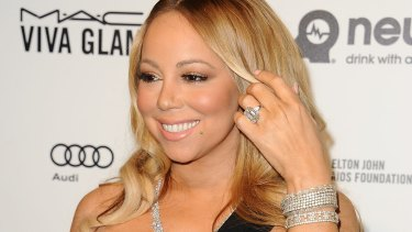 Mariah Carey flashes her $10 million engagement ring at an event in February.
