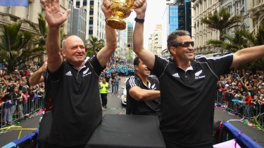 Pedigree: Former New Zealand coach Graham Henry (L) and current assistant coach Wayne Smith (R) hold up the Webb Ellis Cup after the All Blacks' 2011 RWC win.