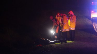 Emergency services personnel search drains at the park.