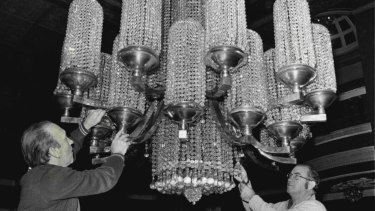 The Regent boasted one of the largest chandeliers in Australia, seen here undergoing major restoration work in 1976.