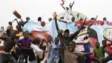Residents celebrate the presidential victory of Muhammadu Buhari in Kaduna, Nigeria.