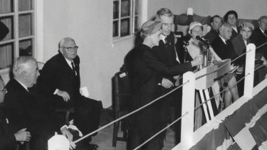 Dame Pattie Menzies, assisted by the Chairman of the Snowy Mountains Authority, Sir William Hudson, closing the switch that brought to life the first of the Snowy Mountain Scheme's huge underground power stations, T.1 in 1959. Seated on the left are prime minister Robert Menzies and the minister for national development Bill Spooner.