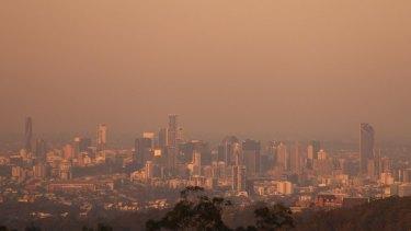 The smoke from the Sunshine Coast bushfire hung over Brisbane on Friday evening.