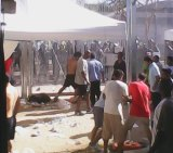 The Refugee Action Coalition says this picture shows the attacks on protesters at Manus Island on Friday.