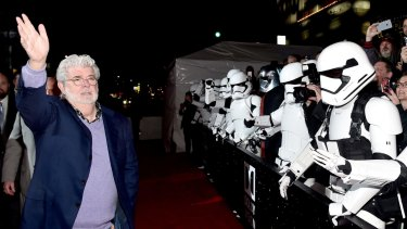 George Lucas, guarded by Stormtroopers, at the world premiere of <i>Star Wars: The Force Awakens</i> in Hollywood. The film is tipped to be huge at the Australian box office.
