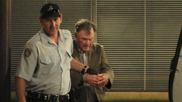 Murderer Ian Turnbull is escorted out of court during the trial.