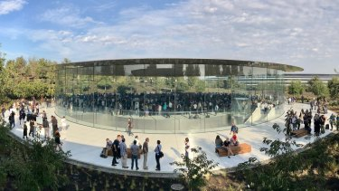 The Steve Jobs Theatre at Apple Park, with the glass-encircled waiting room at ground level, theatre beneath and the main campus visible to the right.
