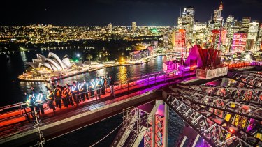 First Night of the iconic festival from on top of Sydney Harbour Bridge ... a climbing group in flashing jackets.