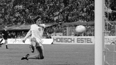 Johan Cruyff jumps to hit the ball into the net for his team's second goal against Brazil in their World Cup match in 1974.