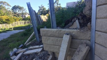Police lay fraud charges after questions over collapsing retaining walls.
