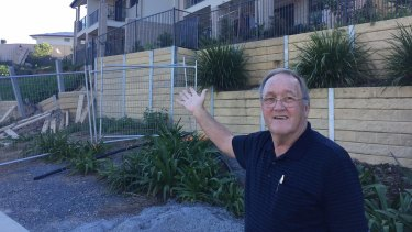 Dan Russell believes little is being done to fix the problems faced by the people living in the units if the soil slips continue.