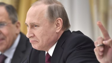 Russian President Vladimir Putin grimaces as he listens to John Kerry at the Kremlin in Moscow late last month.