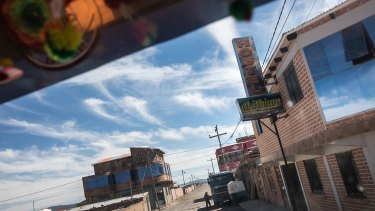 A truckie's view of a town along the Rio Grande.