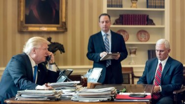 President Donald Trump, accompanied by Chief of Staff Reince Priebus and Vice-President Mike Pence, speaks on the phone with  Russian President Vladimir Putin.
