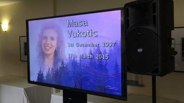 A screen at the funeral for slain schoolgirl Masa Vukotic.
