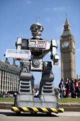 A robot distributes promotional literature calling for a ban on fully autonomous weapons in London's Parliament Square last year.