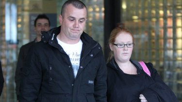 Justin Wright with his partner Aimee Sassine, the parents of Skye Sassine, outside the Downing Centre Courts during the trial of William Ngati in 2012.
