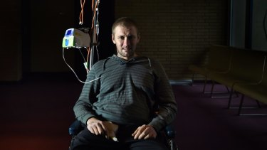 Matt Tudor, 30, sits in his wheelchair in Westmead Hospital as he recovers from horrific car crash injuries.