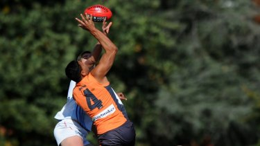 Contesting the ruck for Greater Western Sydney Giants in the AFL in 2012.