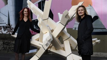 Professors Jill Bennett and Katherine Boydell with a model of the interactive game Catch the Tiger, which will be used to test reactions to changes in environment and fluctuating anxiety levels.