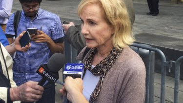Lyn Ulbricht, mother of Ross Ulbricht, speaks to journalists outside court.