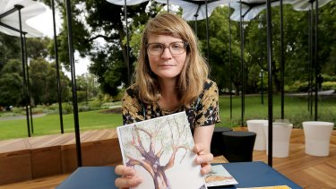 Caitlin Franzmann with one of her 'cards' in the Queen Victoria Gardens.