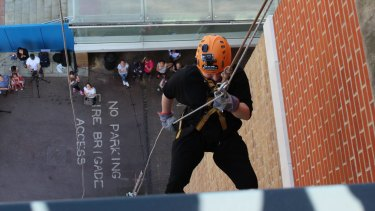 Hicks abseiling in London in June to raise funds for the hospital that saved her life.