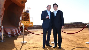 Tony Abbott shows Shinzo Abe a Rio Tinto iron ore mine in Western Australia.
