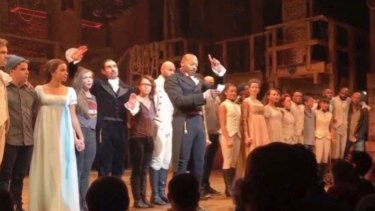In this image made from a video, actor Brandon Victor Dixon who plays Aaron Burr, the nation's third vice-president, in <i>Hamilton</i> speaks from the stage after the curtain call in New York on Friday.