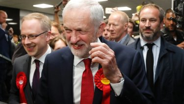 Labour Party leader Jeremy Corbyn smiles after arriving at his constituency in London.