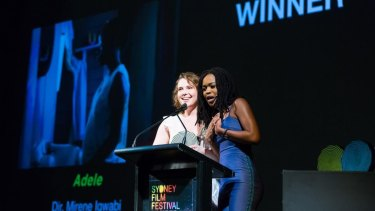 Writer and director Mirene Igwabi with producer Grace Julia accept the award at the Sydney Film Festival.