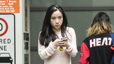 Yingying Dou, director of the MyMaster website, leaves the Sydney premises where she works.