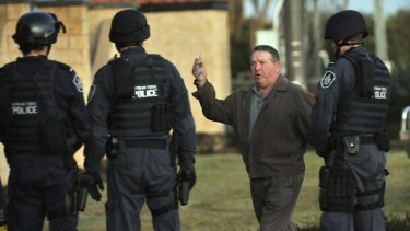 Francesco 'Little Trees' Barbaro confronts AFP officers outside his son Pat's Griffth property.