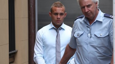 One-punch killer Kieran Loveridge is escorted from the NSW Supreme Court in November 2013.