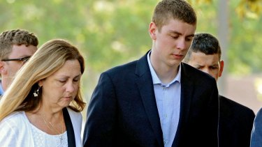 Brock Turner, right, attends court.