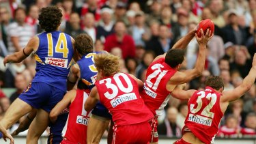 You star: Leo Barry takes a game-saving mark.