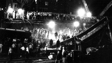 Rescue workers at the scene of the disaster on January 18, 1977.
