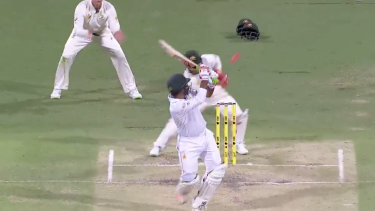 Missed stumping: Matthew Wade can't catch the ball, missing a stumping against Pakistan.