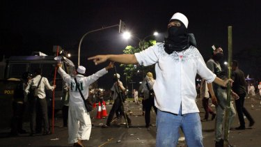 Protesters clash with police at the end of an anti-Ahok rally in Jakarta in November.