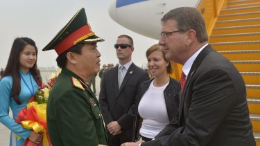 US Secretary of Defence Ash Carter and his wife Stephanie are met by an officer of the People's Army of Vietnam as they arrive at Cat Bi International Airport outside of Hanoi.
