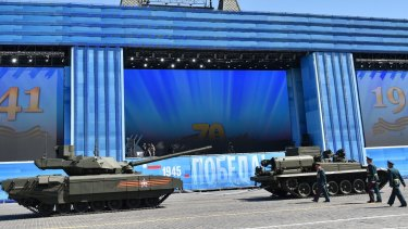 A Russian T-14 Armata tank (left) is ready to be towed during a rehearsal for the Victory Day military parade on Moscow's Red Square.