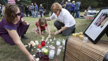 Sarah Canham, left, and daughter Ada, 4,   with Zee Meyer at a vigil for missing man and Meyer's husband, Warren.